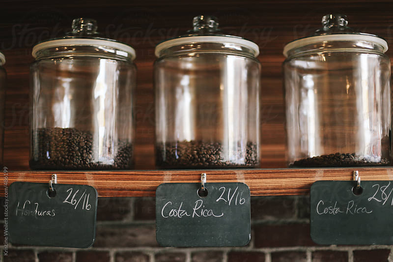 Variety of Coffee Beans being Displayed on Shelf by Kristine Weilert for Stocksy United