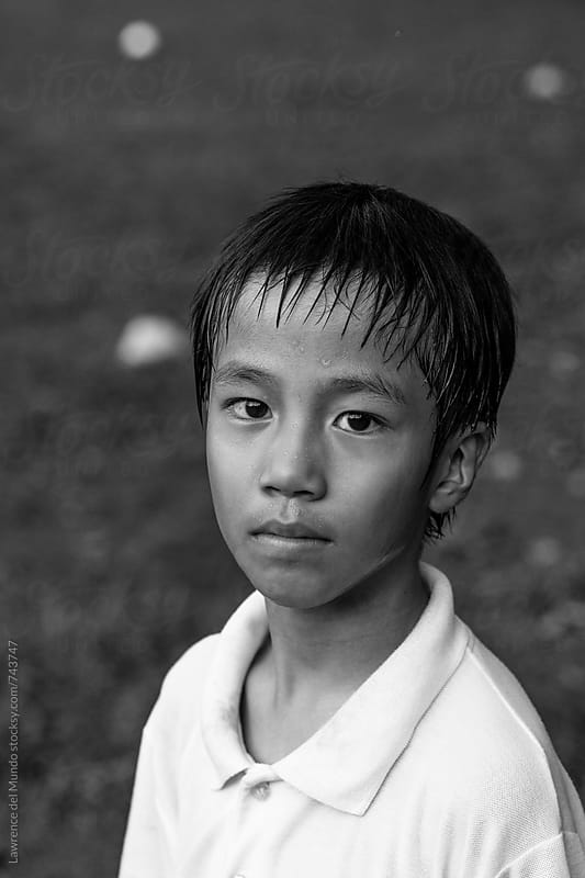 Portrait of a young football player putting on his game face by Lawrence del Mundo for Stocksy United
