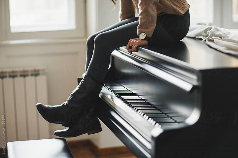 Woman Sitting on the Piano by Lumina for Stocksy United