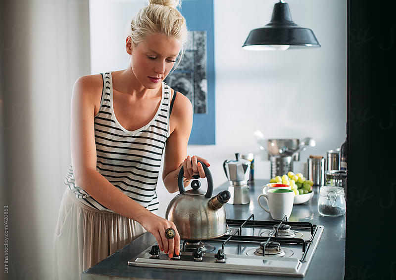Caucasian Woman in a Modern Kitchen by Lumina for Stocksy United