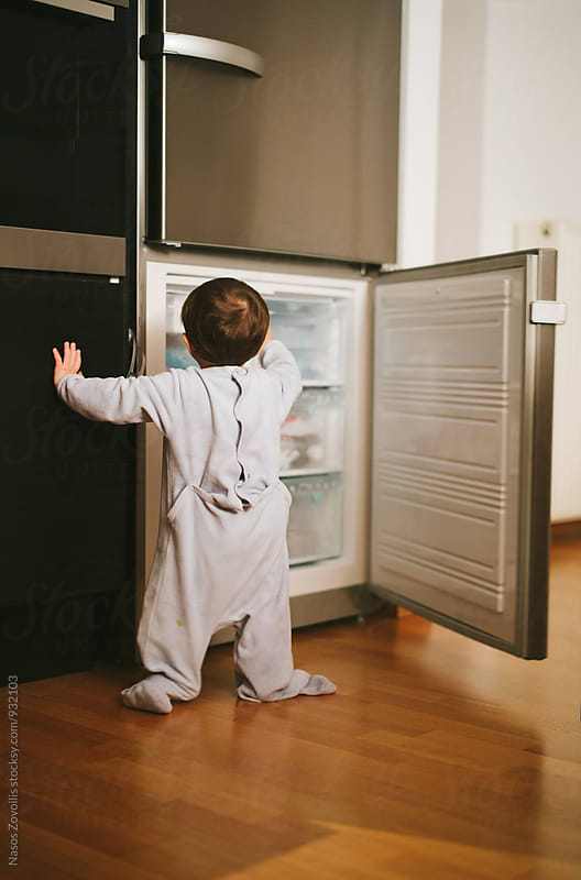 1 year old boy in front of a refrigerator by Nasos Zovoilis for Stocksy United