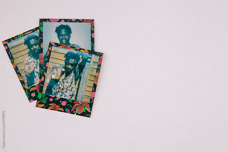 Polaroids of a tattooed black man  by kkgas for Stocksy United