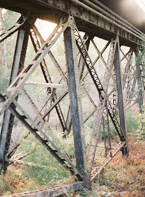 Rusty railroad bridge  by Vicki Grafton Photography for Stocksy United