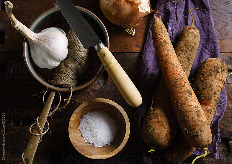 Ingredients for making soup in a rustic setting. by Darren Muir for Stocksy United