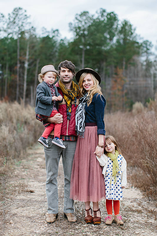 A beautiful family standing in the middle of a dirt road by Jakob for Stocksy United