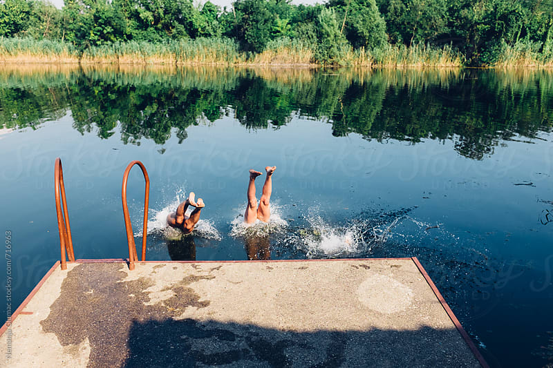 Three Men Diving in the Lake Head First by Nemanja Glumac for Stocksy United