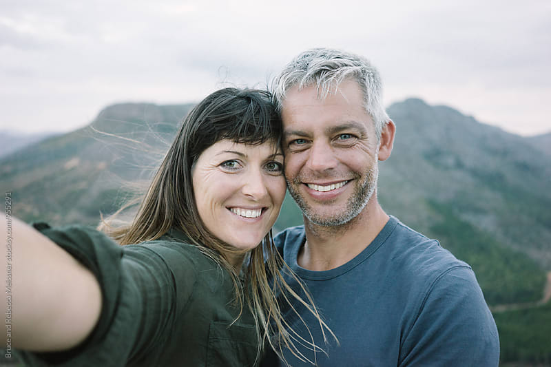 Couple taking a selfie by Bruce Meissner for Stocksy United