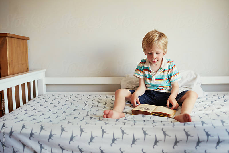 Child reading a book by sally anscombe for Stocksy United