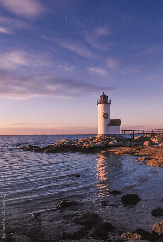Christmas Wreath on New England Lighthouse by Raymond Forbes LLC for Stocksy United