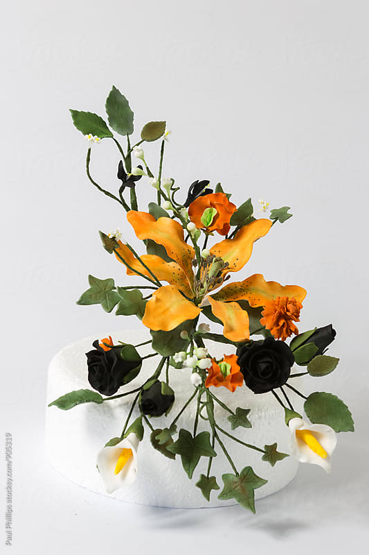 Edible floral cake display made from flower paste. On white background. by Paul Phillips for Stocksy United
