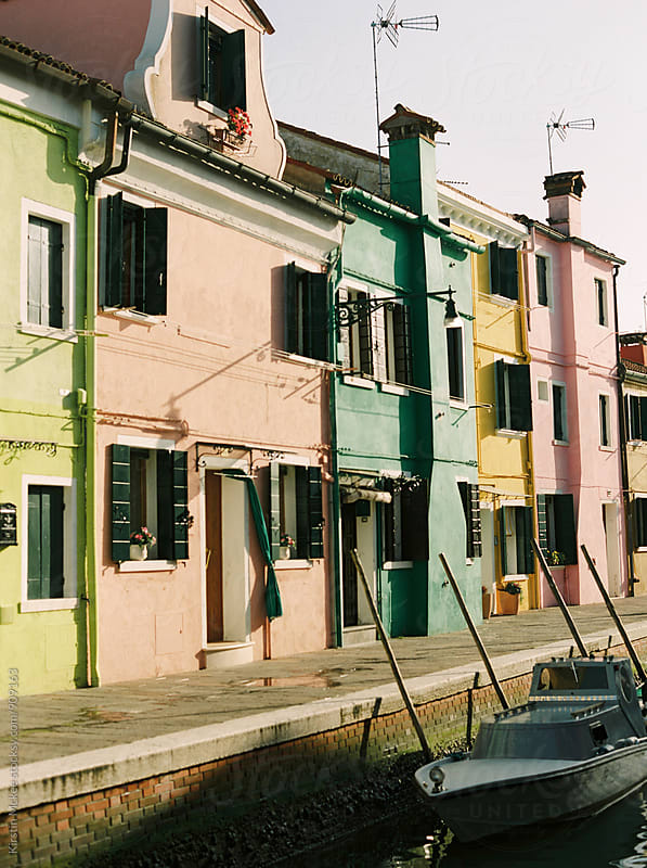 Houses next to a canal in Burano, Venice by Kirstin Mckee for Stocksy United