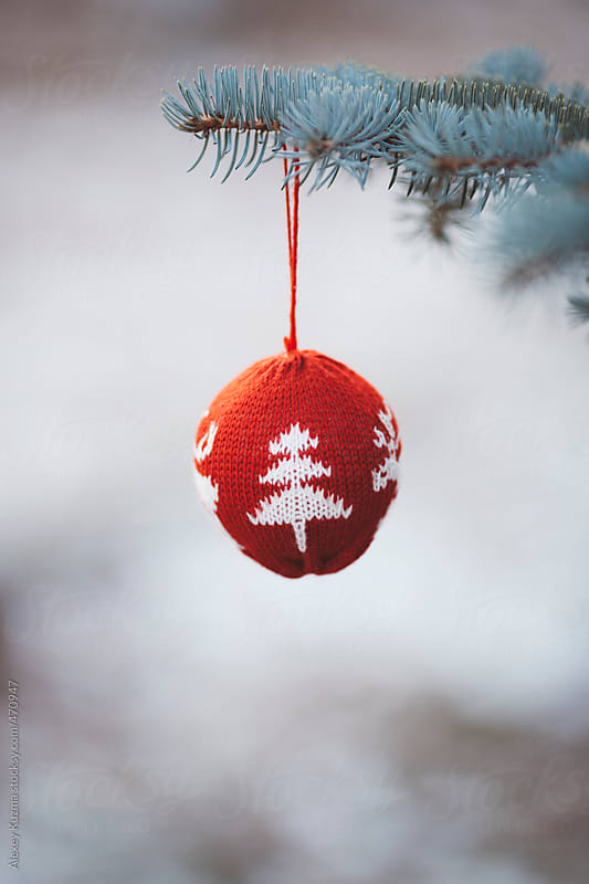 Red Christmas Ornament  hanging in a fir tree by Alexey Kuzma for Stocksy United