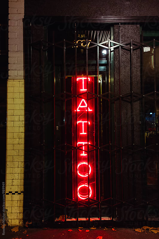 Tattoo in neon lights by Rowena Naylor for Stocksy United