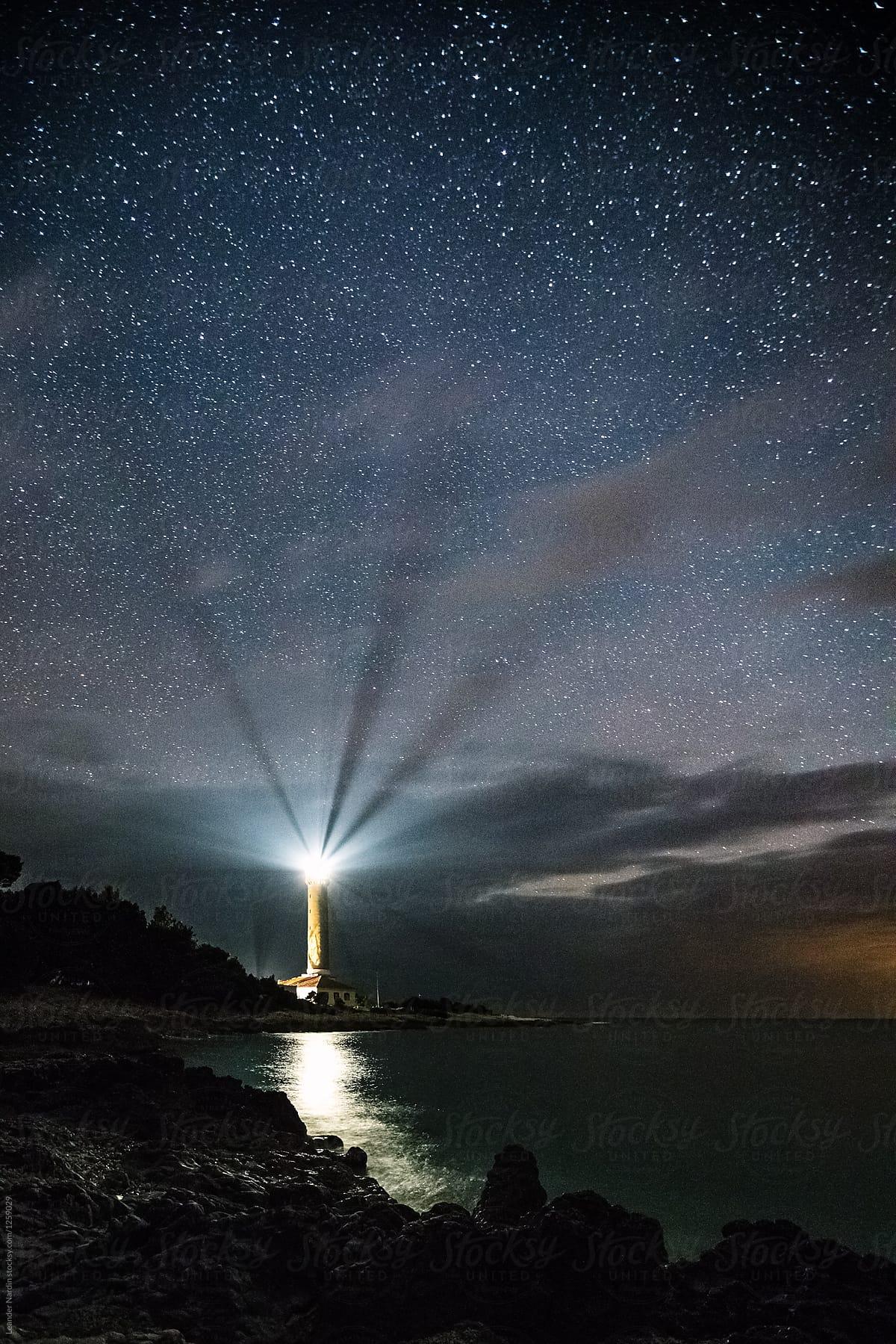 Lighthouse Under Starry Night Sky | Stocksy United