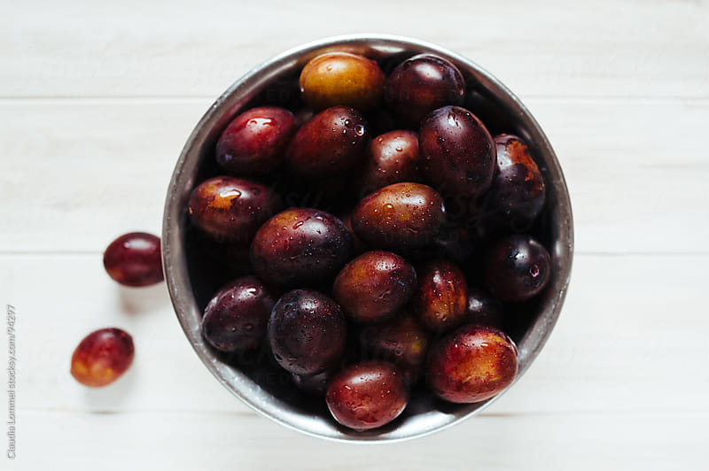 Freshly Washed Plums in a Metal Bowl by Claudia Lommel for Stocksy United
