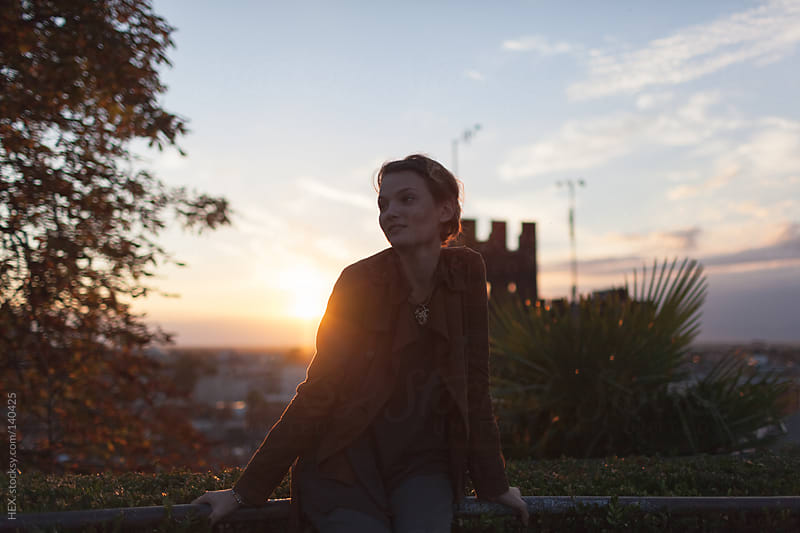 Smiling Woman Portrait At Sunset by HEX. for Stocksy United