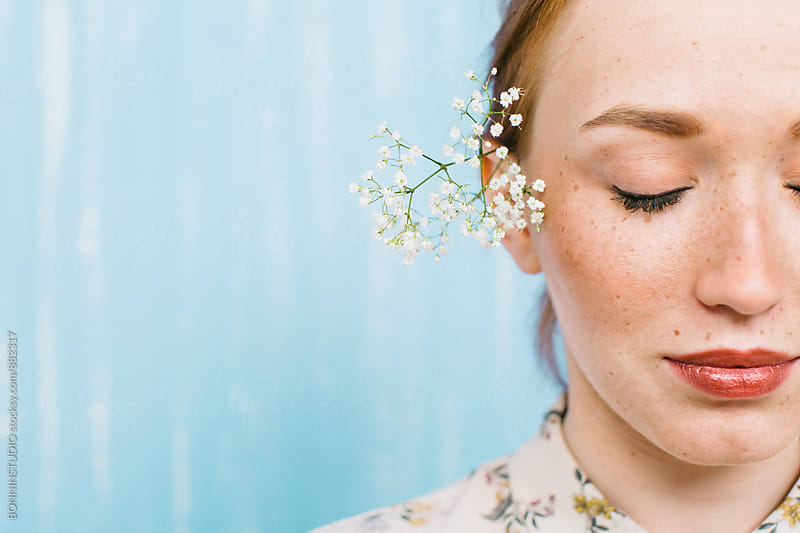 Portrait of a young freckled woman. by BONNINSTUDIO for Stocksy United