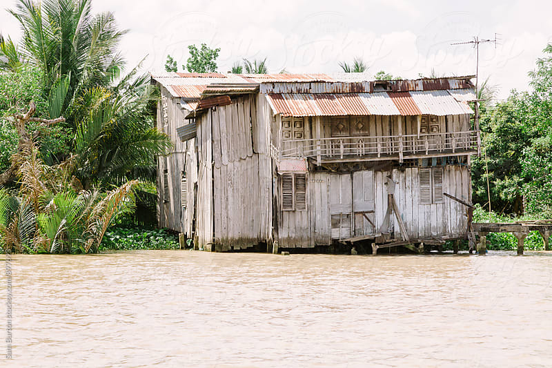 Old building on the banks of the Mekong Delta by Sam Burton for Stocksy United