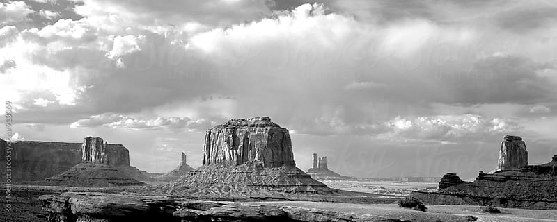Monument Valley Arizona in winter with storms passing over the valley by Ron Mellott for Stocksy United