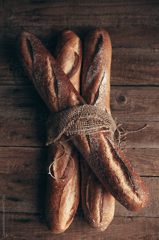 Baguettes Tied Together by Lumina for Stocksy United