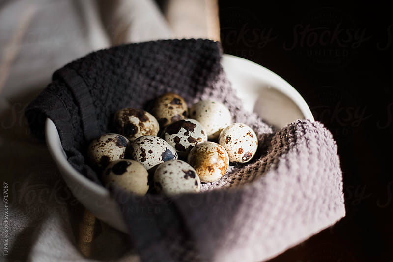 Quail eggs in a bowl on the table by TJ Macke for Stocksy United