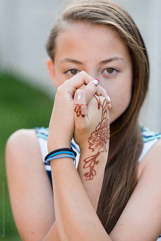Teen Girl Displaying Henna Art by Ronnie Comeau for Stocksy United