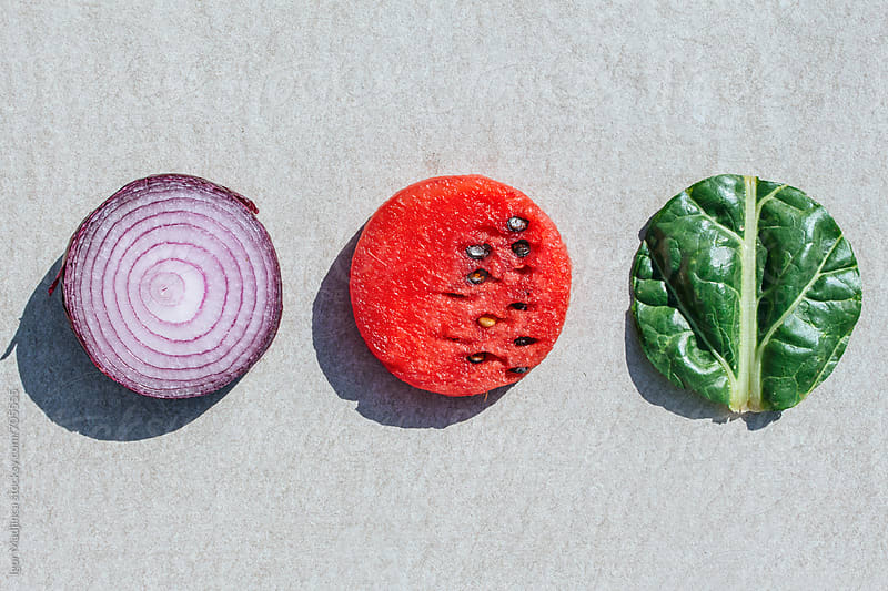 fruits and vegetables, cut into a circle by Igor Madjinca for Stocksy United