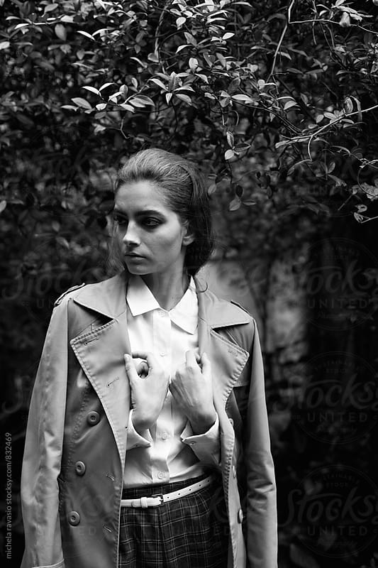 Charming woman with a trench coat by michela ravasio for Stocksy United