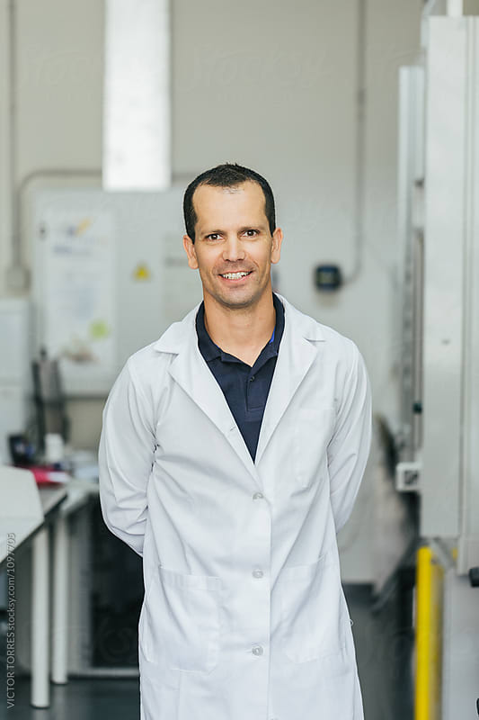 Corporate Portrait of a Biologist in a Professional Laboratory by VICTOR TORRES for Stocksy United