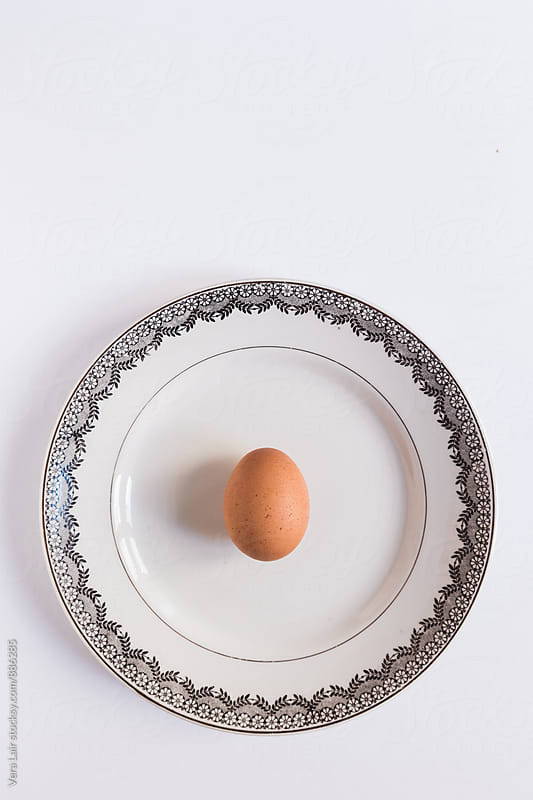 A egg on a plate by Vera Lair for Stocksy United