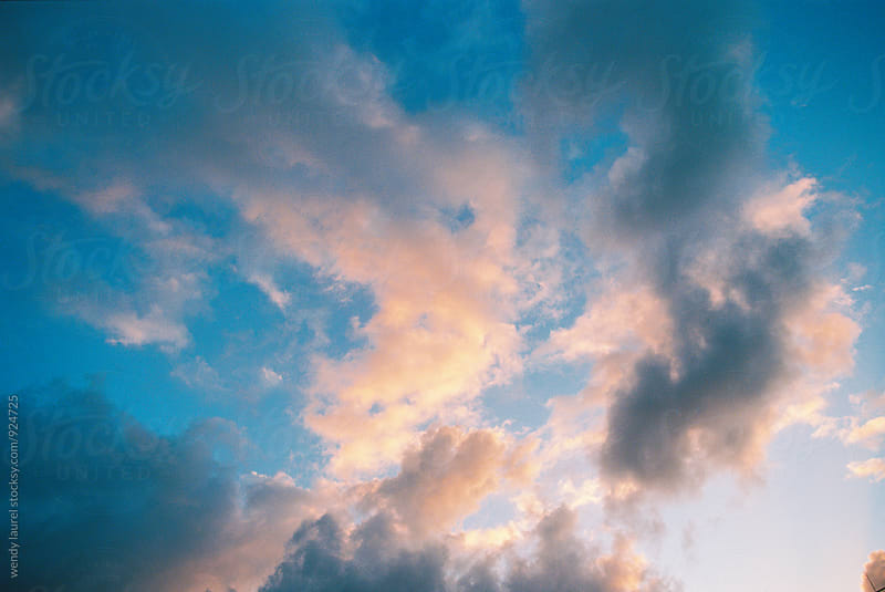 sunrise sky with blues and pinks in hawaii by wendy laurel for Stocksy United