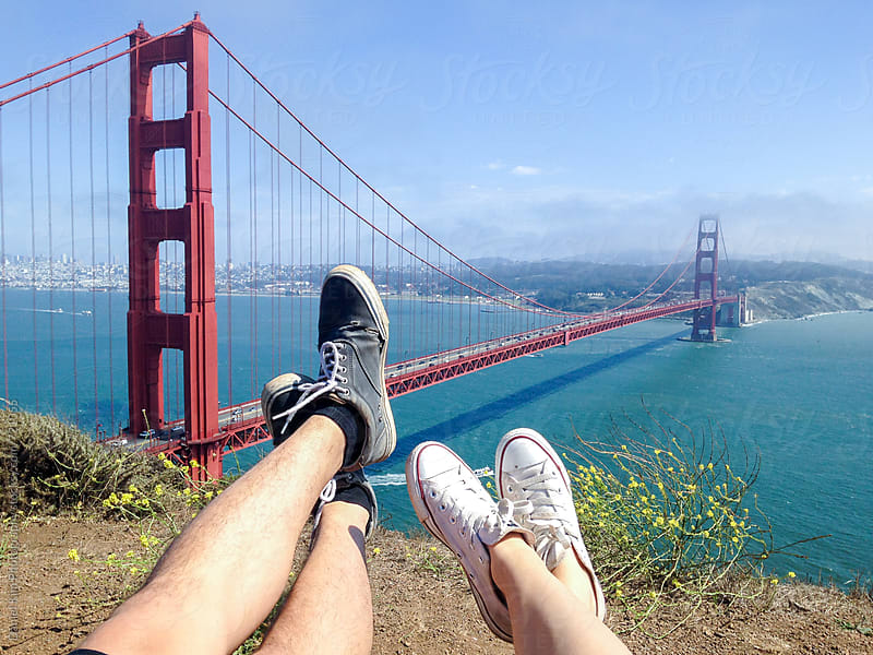Couples feet in front of Golden gate bridge by Daniel Kim Photography for Stocksy United