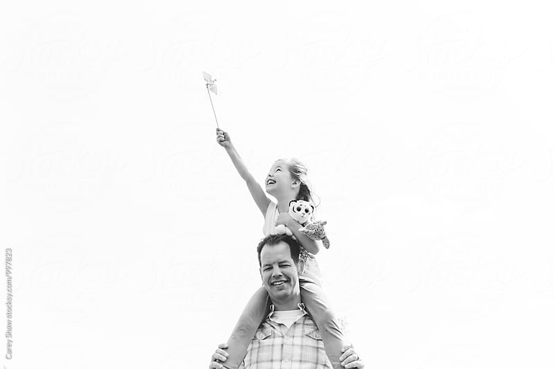 Black and white portrait of father and daughter having fun together by Carey Shaw for Stocksy United