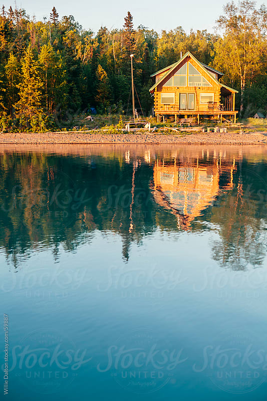Cabin on a Lake by Willie Dalton for Stocksy United