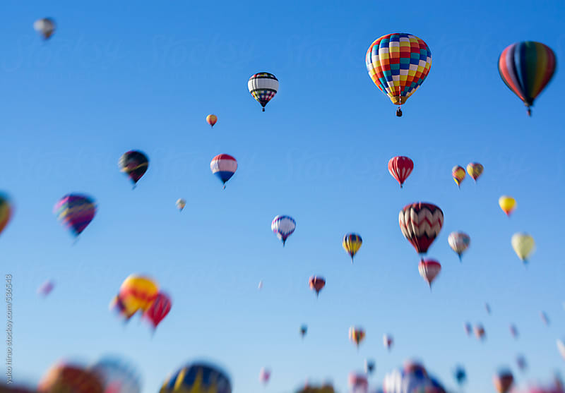 Hot air balloons assending into the blue sky by yuko hirao for Stocksy United