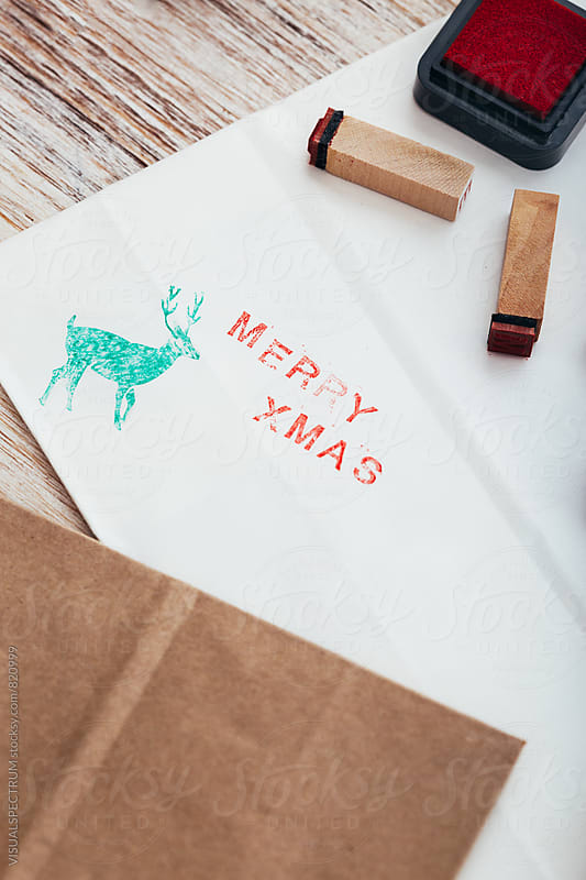 Christmas - Close Up of Merry Xmas Written on White Paper With Stamped Letters by Julien L. Balmer for Stocksy United