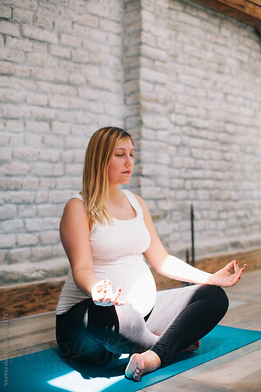 Woman meditating indoor by VeaVea for Stocksy United