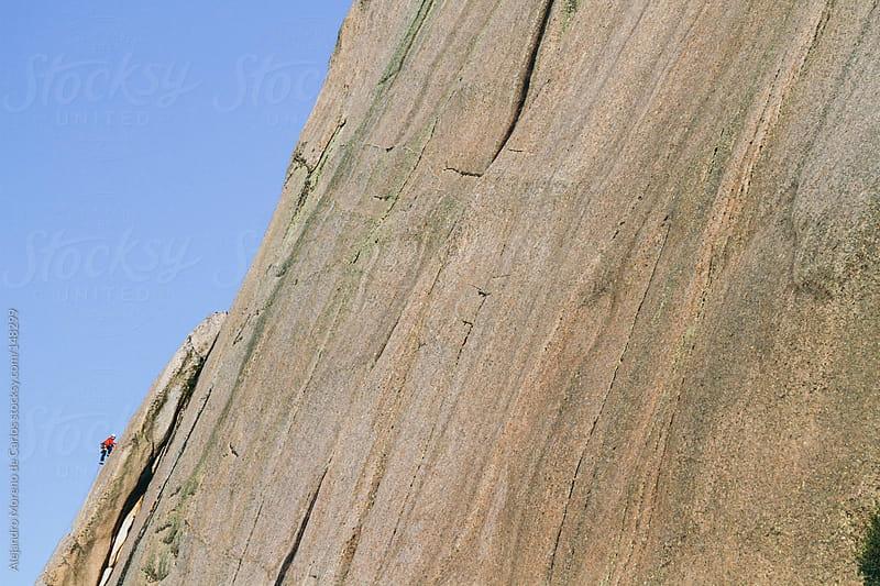 Climber on big rock wall by Alejandro Moreno de Carlos for Stocksy United