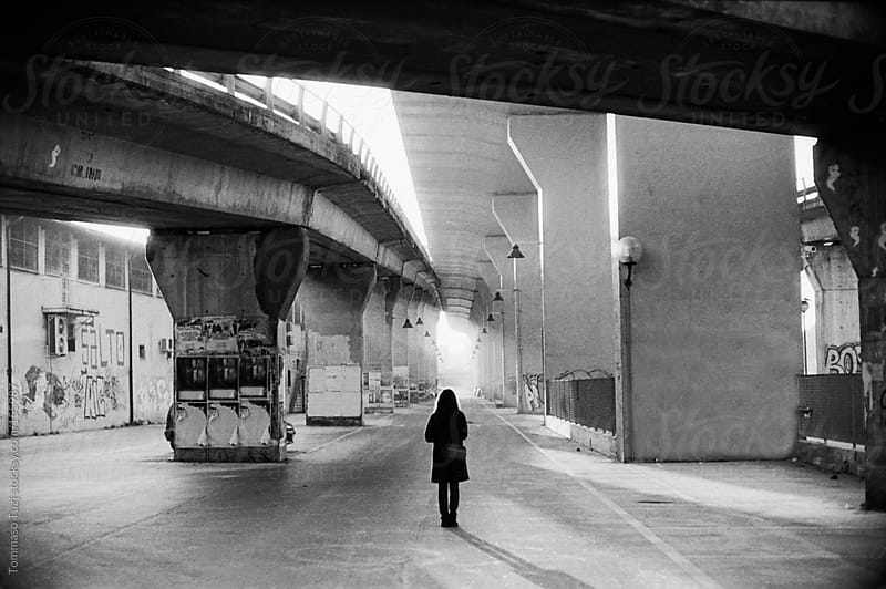 girl under the bridge by Tommaso Tuzj for Stocksy United