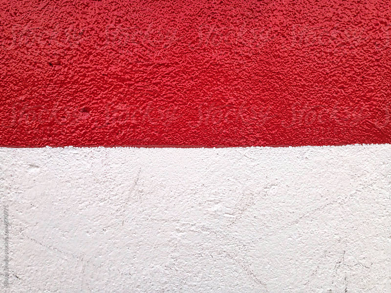 Close up of painted red lines on bright white wall by Bisual Studio for Stocksy United