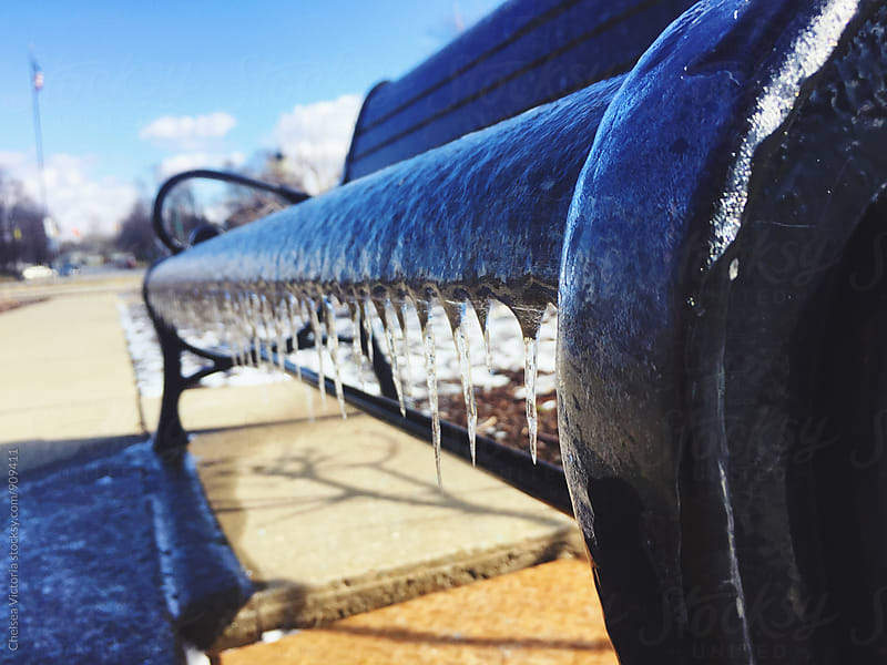 Frozen park benches in the city by Chelsea Victoria for Stocksy United