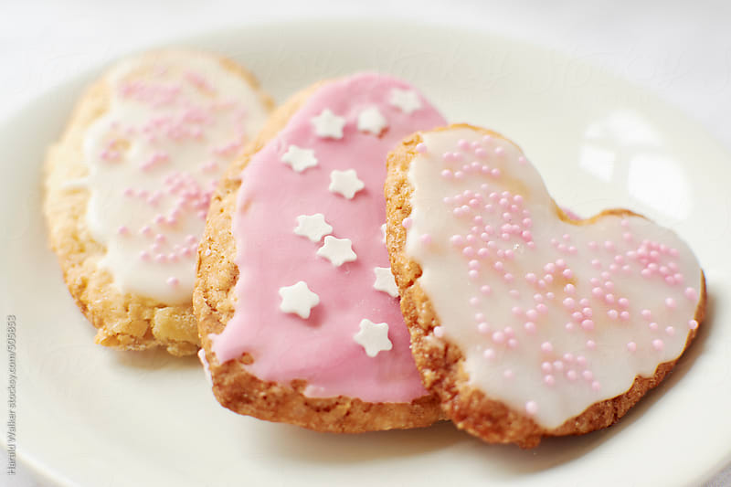 Heart shaped sugar cookies by Harald Walker for Stocksy United
