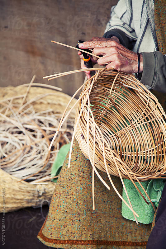Older hands making a wicker basket by VICTOR TORRES for Stocksy United