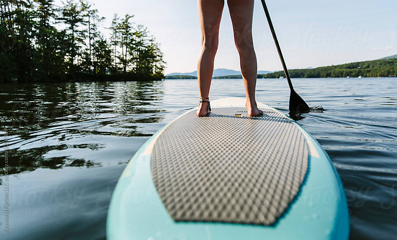 Stand Up Paddleboarding by Raymond Forbes LLC for Stocksy United