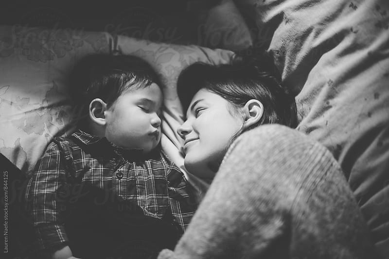 Mom and toddler baby napping by Lauren Naefe for Stocksy United