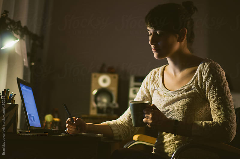 Woman Working Late at Home  by Brkati Krokodil for Stocksy United