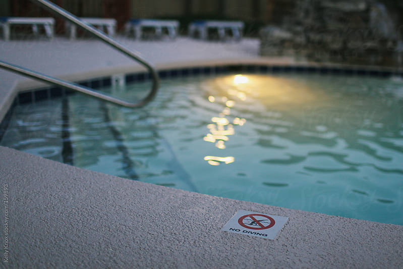 no diving in the pool by Kelly Knox for Stocksy United