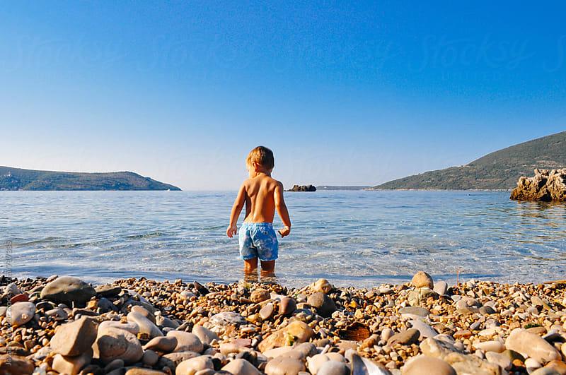 Boy and sea by Jovana Vukotic for Stocksy United