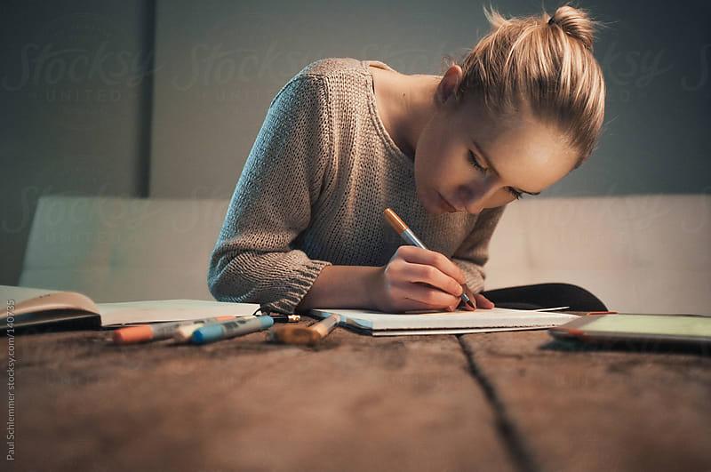 Art student doing homework by Paul Schlemmer for Stocksy United
