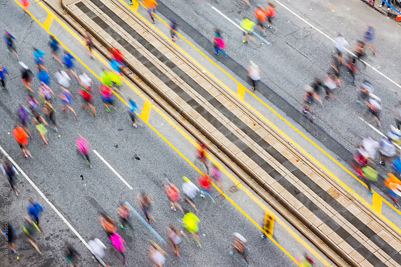 Colorful marathon runnered viewed from above by yuko hirao for Stocksy United